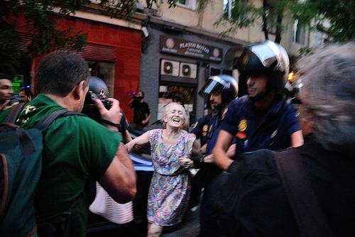 Fotorreportero manifestación policia antidisturbios